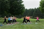 Outdoor yoga at Lake Elmo Park Reserve.