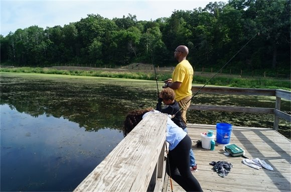 Fishing from the pier at Cottage Grove Ravine Regional Park.