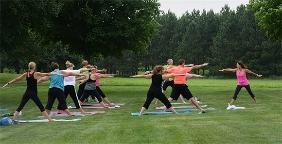 An outdoor yoga class at Lake Elmo Park Reserve.