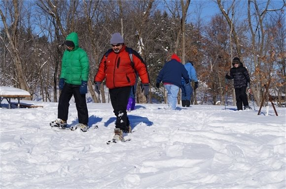 Participants take off on snow shoes during WinterFest.