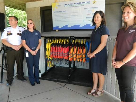 Washington County Sheriff Dan Starry, Washington County Parks Director Sandy Breuer, Shonette Doggett, injury prevention coordinator at Regions Hospital and Gillette Children's, and Minnesota Department of Natural Resources Safety Outreach Coordinator Lisa Dugan Monday at the new lifejacket loan station at Lake Elmo Park Reserve.