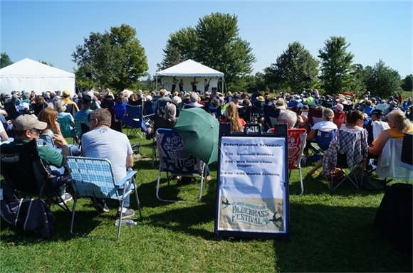 The crowd listens to the bands at the Bluegrass Festival.