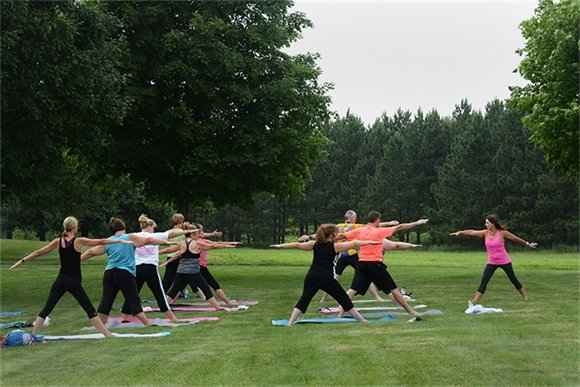 Outdoor yoga class at Lake Elmo Park Reserve