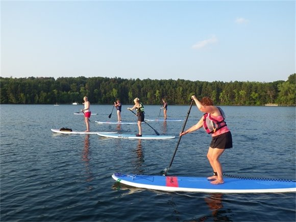 Standup paddleboarding at Square Lake Park.