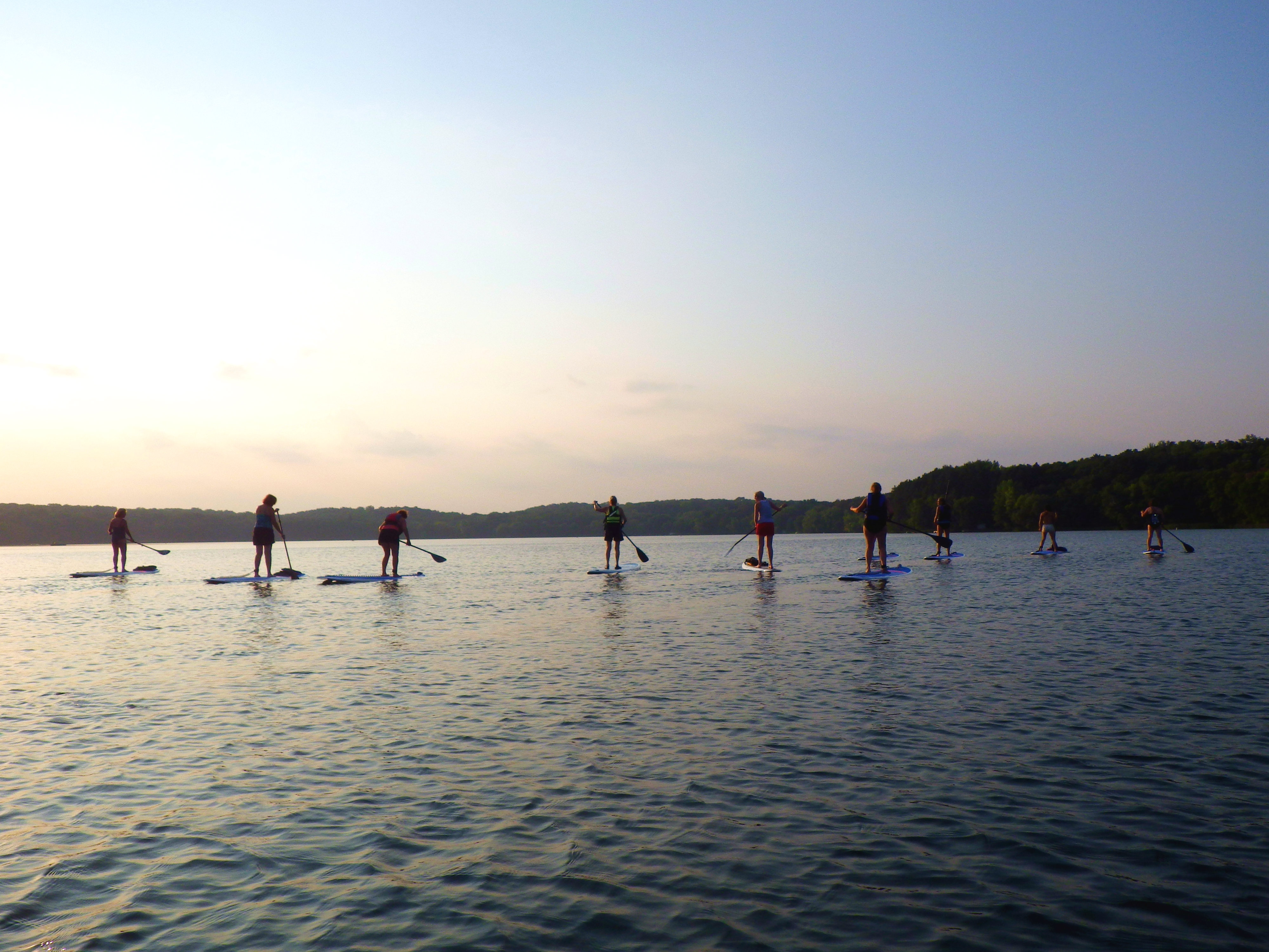 Stand-up paddleboard sunset paddle class at Square Lake Park.