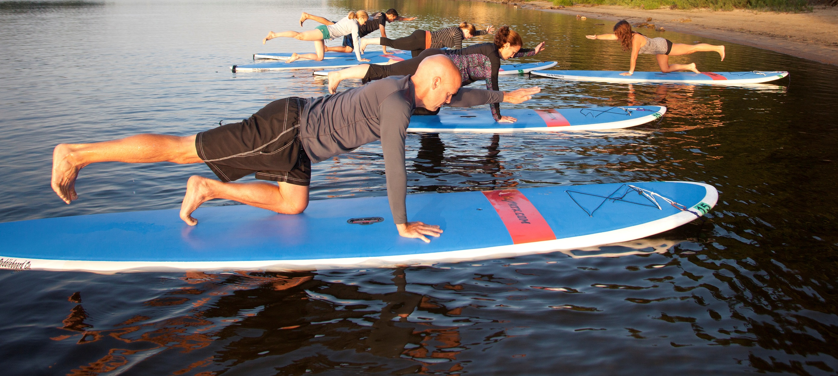 Stand-up Paddleboard yoga on Square Lake