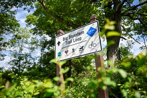 A sign for the Bluestem Trail Loop at Lake Elmo Park Reserve
