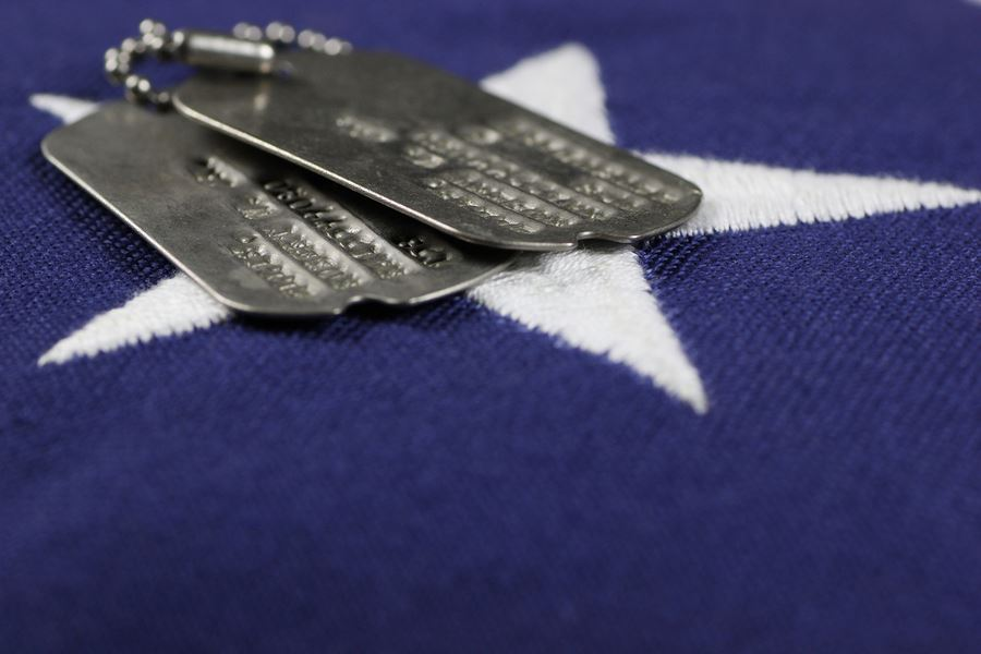 bigstock-Dog-Tags-On-Flag-49265165-VetsSvsComSvs